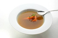 vegetable soup with organic carrot and a spoon