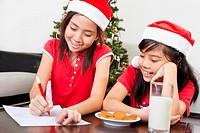 Kids busy preparing letter to Santa