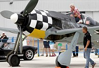 (150726) -- VANCOUVER, July 26, 2015 () -- A visitor takes a close look at a vintage aircraft on display at the Boundary Bay air show in Delta, Canada...