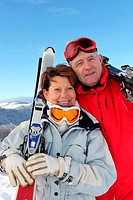 two seniors skiing in the mountain