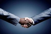 Handshake - Hand holding on black