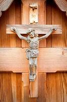 Wood rustic sculpture of Jesus crucified