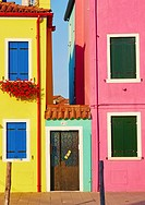 Entrance between two colourful houses, Burano, Venetian Lagoon, Veneto, Italy, Europe.