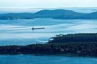 A ship passes Pender Island Gulf Islands, British Columbia, Canada