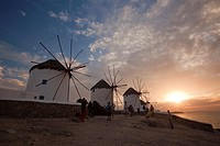 Traditional windmills in Mykonos town at sunset, Mykonos, Cyclades Islands, Greek Islands, Greece, Europe.