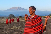Maasai (Masai) elders with Mount (Mt) Kilimanjaro in the background. Satao Elerai Conservancy. Near Amboseli National Park. Kenya.