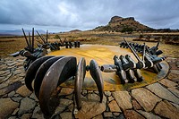 The Monument to the fallen Zulu Warriors at Isandlwana Battlefield. KwaZulu Natal Midlands. South Africa. The monument is in the form of a large bronz...