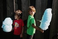 Boys eating cotton candy in Legoland, Billund. Denmark.