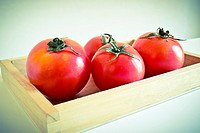 Tomatoe. Tomatoes in a wooden box.