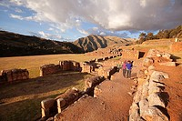 Tourists near the ancient Inca walls in Chinchero Ruins, Chinchero, Valle Sagrado, Cuzco, Peru, South America.