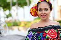 Young woman wearing traditional Mexican costume while smiling at camera. Puerto Vallarta, Jalisco, Mexico.