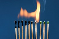 A row of match sticks had been ignited and are burning down.