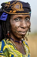 Portrait of a Mbororo woman from Cameroon with the typical scarification of this tribe on her face.