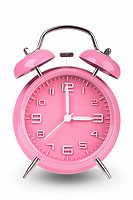 Pink alarm clock with the hands at 3 am or pm isolated on a white background.