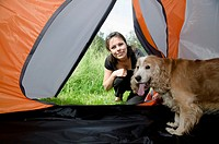 Woman watching inside a tent with her cute cocker spaniel dog in Ticino, Switzerland.