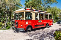 Red Tourist Trolley car offers free rides to visitors to West Palm Beach, Florida.