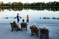 Florida, Orlando, Celebration, master-planned community, neo-urbanism, downtown, Front Street, Lake Rianhard, rocking chairs, scenery, water, couple, ...