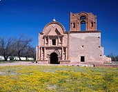USA, Arizona, Tumacacori National Historical Park, Remains of mission church San Jose de Tumacacori, originally built in early 1800´s, and spring wild...