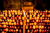 Candles in a Carcassonne church, France.