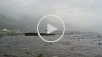 Rain in slow motion falling down on alpine lake Maggiore in Ticino, Switzerland.