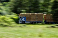 Truck with straw bales driving on the road to the Savoy.Chartreuse, Isere, Rhone Alpes, Alps, France.
