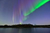 Aurora borealis over a small boreal pond, near Enterprise, Northwest Territories, Canada.