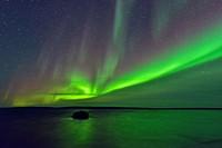 Aurora borealis (Northern lights) over Ennadai Lake, Arctic Haven Lodge, Ennadai Lake, Nunavut, Canada.