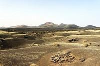 Volcanic cones and lava fields of Timanfaya National Park, Lanzarote, Canary Islands. Looking NW from Caldera de los Cuervos.