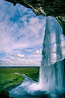 Scenic view of Seljalandsfoss Waterfall against sky. Iceland.
