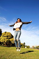 A young woman jumping in the Park.