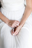 Hands of the bride in her lap
