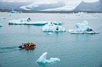 tourists in a boat at Jokulsarlon glacier lake in Iceland