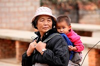 Woman with baby, Yunnan province, China