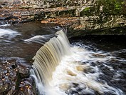 Stainforth Force or Stainforth Foss on the River Ribble in Autumn Stainforth Ribblesdale Yorkshire Dales England.