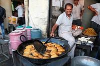 Shree Jodhpur sweets shop is famous for fresh kachoris. Fresh Kachoris being made in the shop in Ajmer, Rajasthan, India.