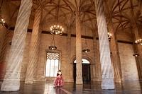 Traditional Dress inside Interior of La Lonja Building, Valencia, Spain.