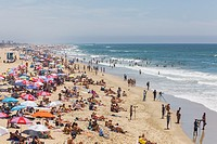 holiday makers on the Huntington Beach, California.