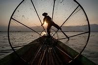 Silhouette of a Inle Lake Fisherman at work, Nyaungshwe, Shan State, Myanmar.