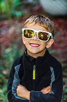 5 year old boy wearing sunglasses, Littleton, Colorado USA.