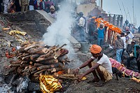 Cremation of a body, in Manikarnika Ghat, the burning ghat, on the banks of Ganges river, Varanasi, Uttar Pradesh, India.