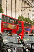 UK, England, London. Iconic London taxicabs and double decker buses in the heart of London.