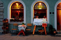 restaurant entrance in the evening with information that they serve traditional Polish dish - Pierogi, Freta street, New Town, Warsaw, Poland, Europe