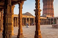 Tourists, in Qutub Minar complex, Delhi, India.