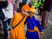 Two young boys pose for the camera whilst they wait for the start of the Vaisakhi celebrations in the Sikh community of Southampton (UK).
