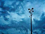 CCTV camera against a stormy sky.