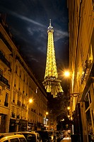 PARIS, FRANCE - AUGUST 25, 2016 : View on illuminated Eiffel Tower from Parisian street in the evening, France.