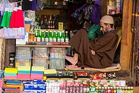 Fes, Morocco. Shopkeeper Dozing, Tala'a Kabira Street, in the Medina.