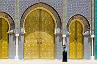 Fes, Morocco. Young Muslim Woman Taking a Selfie in front of the Gateway to the Dar El Makhsen, the King's Palace, Fes El Jedid.