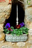 flowers and a stone wall, Lauzun, Lot-et-Garonne Department, Aquitaine, France.