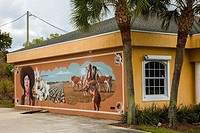 Art murals painted on outdoor building walls in Lake Placid Florida known as the Town of Murals.